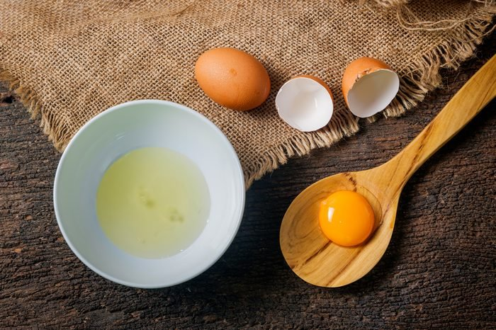 egg yolk in wooden spoon