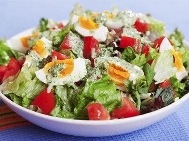 Top salad with an egg.