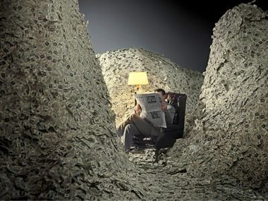 money pile man chair