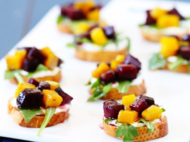 Roasted Beet, Arugula, Goat Cheese, and Honey Crostini