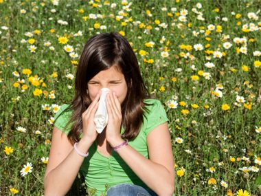 Girl suffering from seasonal allergies