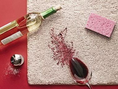 Red wine spilled on beige rug