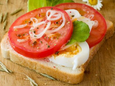 Sliced Egg and Tomato Sandwich with Pesto Mayo