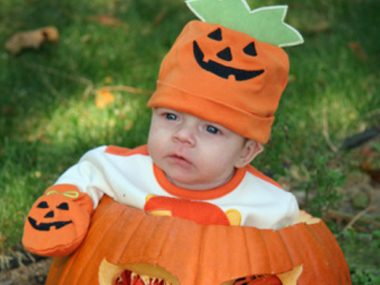 baby dressed as pumpkin for halloween