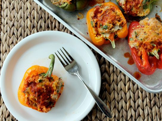 Enchilada chicken and quinoa stuffed peppers