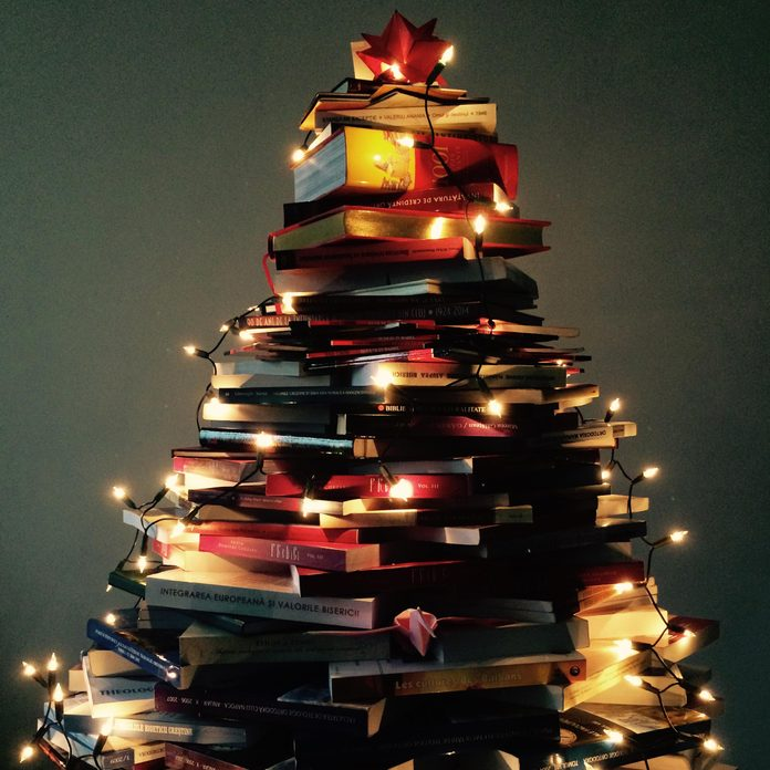 Christmas tree constructed from pile of books
