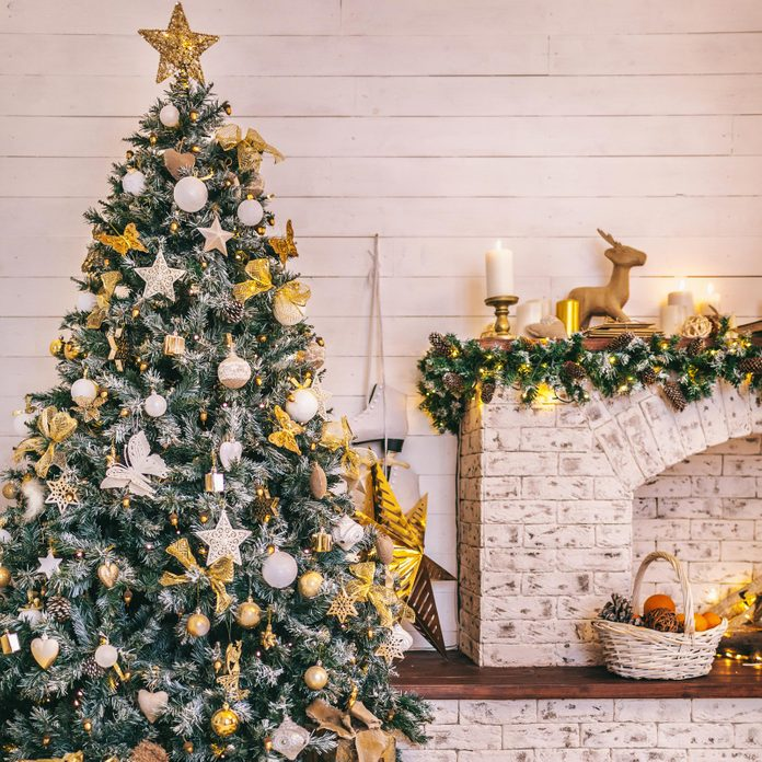 Christmas tree decorated in layers of gold ornaments and beads