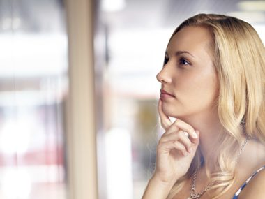 Woman thinking about going shopping