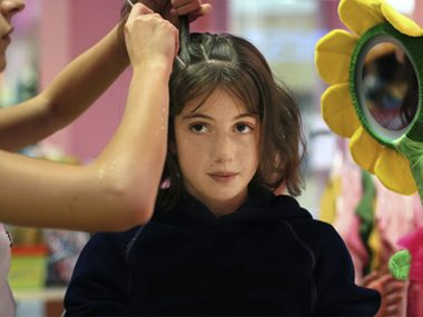 Every year after school starts, at least one mom brings in her daughter with hair down to her waist and tells us to give her a pixie cut.
