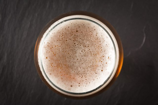 Glass beer on stone background with copy space. wallpaper
