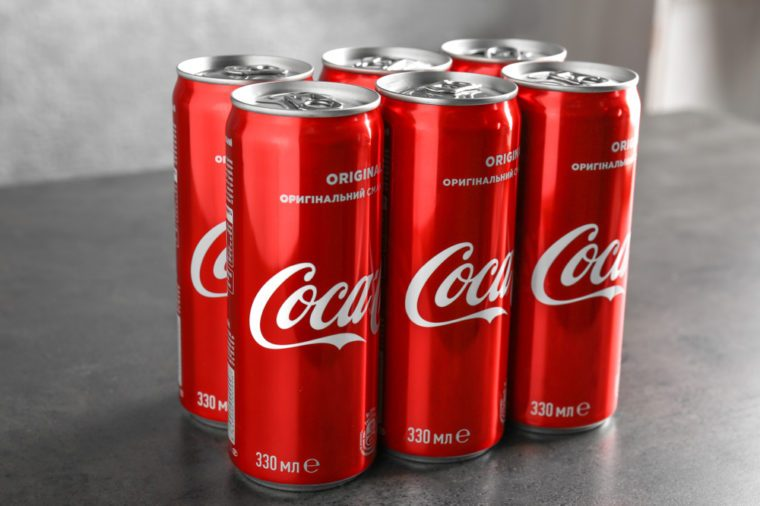 Cans of Coca-Cola on table