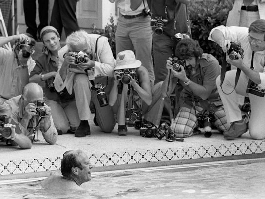 President Ford with photographers by the White House pool, 1975