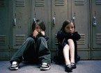 Kids sitting by the locker