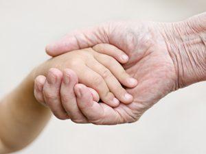 grandmother holding grandchild's hand