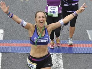 "Everyday Heroes: ""Marathon Queen"" Raises $200,000"
