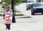 man carrying sign