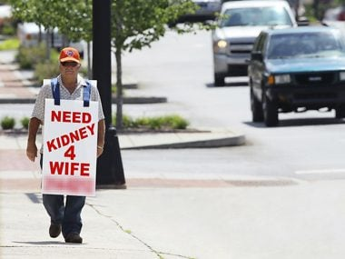 man carrying sign