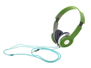 To save money, wear headphones and listen to upbeat music as you shop.
