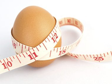 egg with tape measure