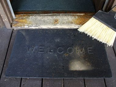 Use doormats with synthetic fibers.
