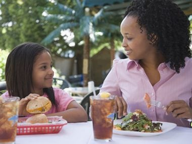 woman and daughter eating