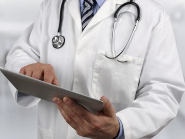 doctor looking at clipboard