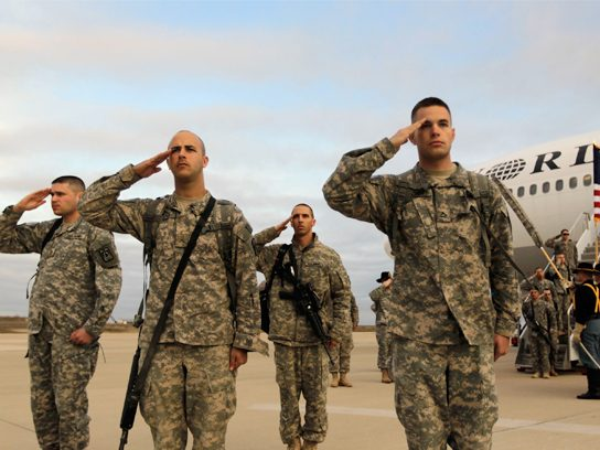 soldiers saluting returning home