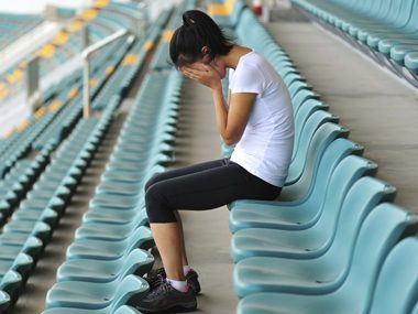 woman sitting in stands