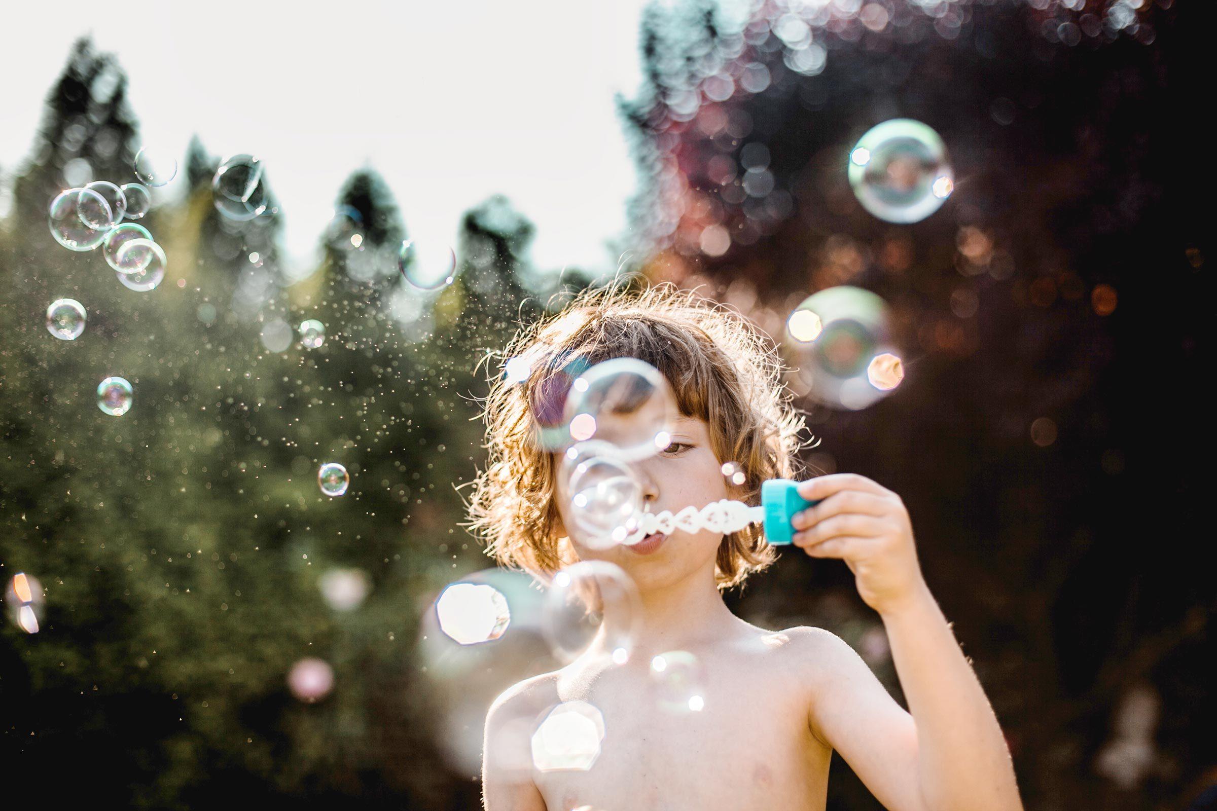 Boy making bubbles