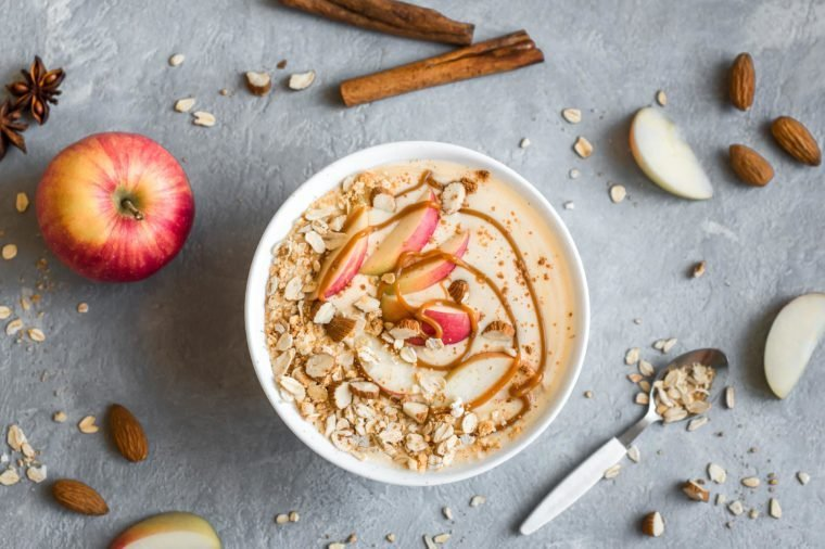 bowl of oatmeal with cinnamon. apples, and almonds