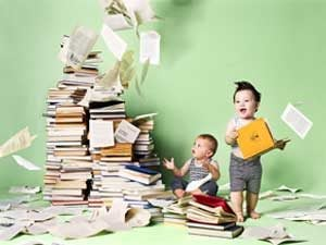 babies holding books