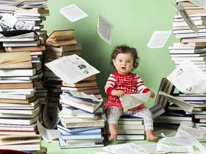 baby sitting on books