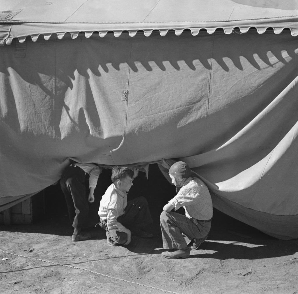 Children Sneaking Under Circus Tent
