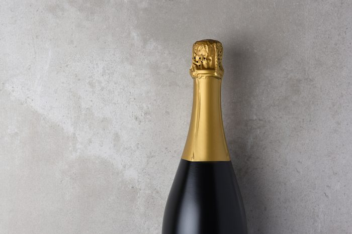 Champagne bottle closeup with copy space.