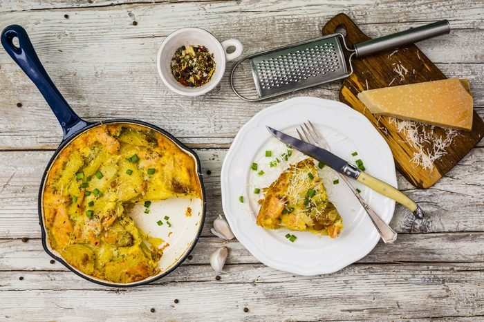 Frittata with potatoes and smoked salmon. Tasty Italian food.