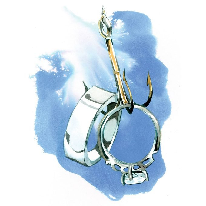 illustration of a fishhook that caught a pair of wedding rings