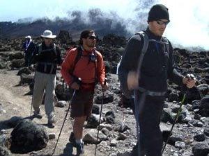 men climbing kilimanjaro
