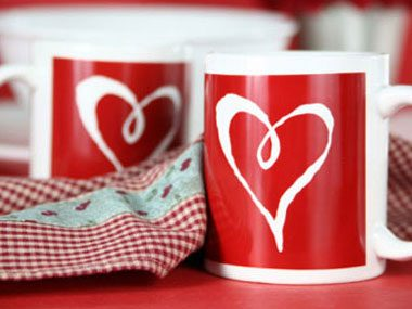 Instead of going out to a four-star restaurant and dining on lobster thermidor by candlelight, consider buying your date a coffee mug with a heart on it.