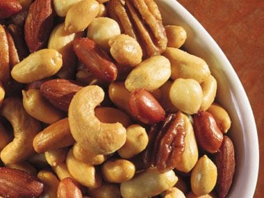 Slash calories by halving nuts.