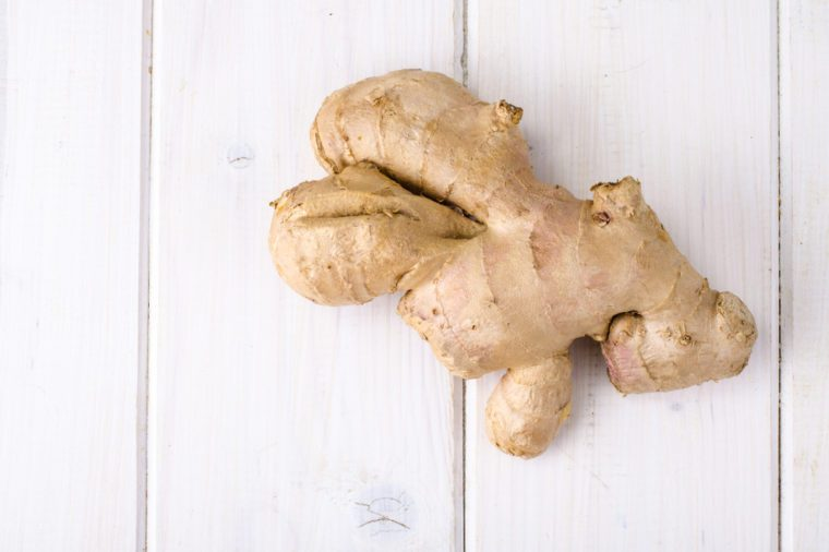 Whole root of fresh ginger. Studio Photo