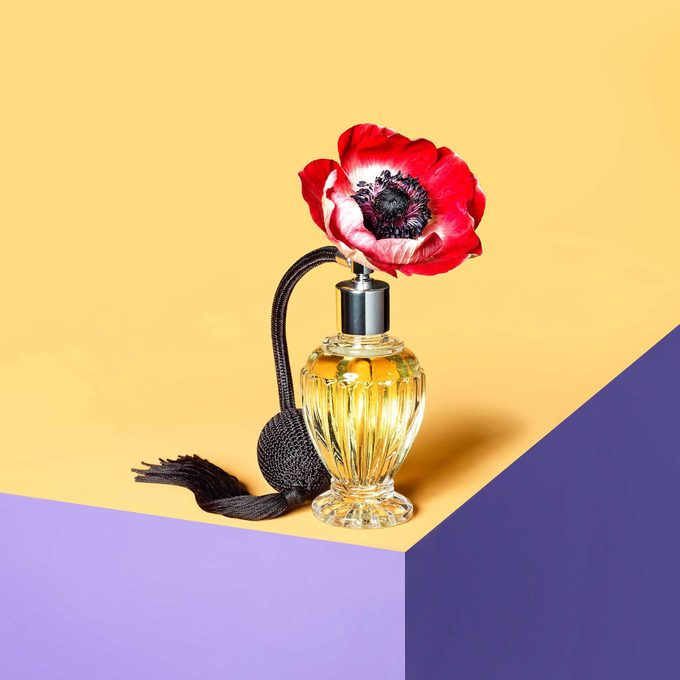 a flower in a perfume bottle