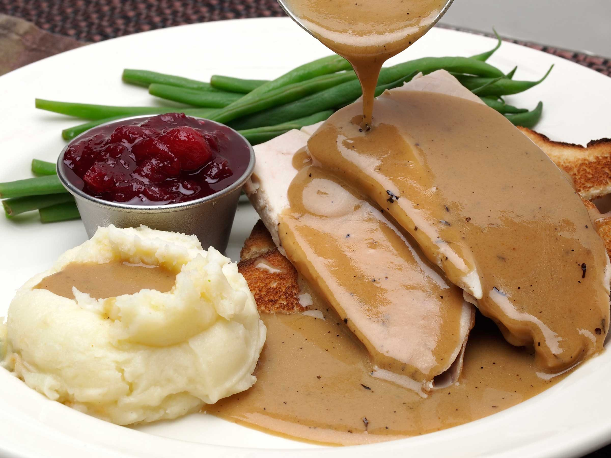 My sister follows a gluten-free diet, and I planned desserts for her but totally forgot about the gravy. How do I thicken gluten-free gravy?