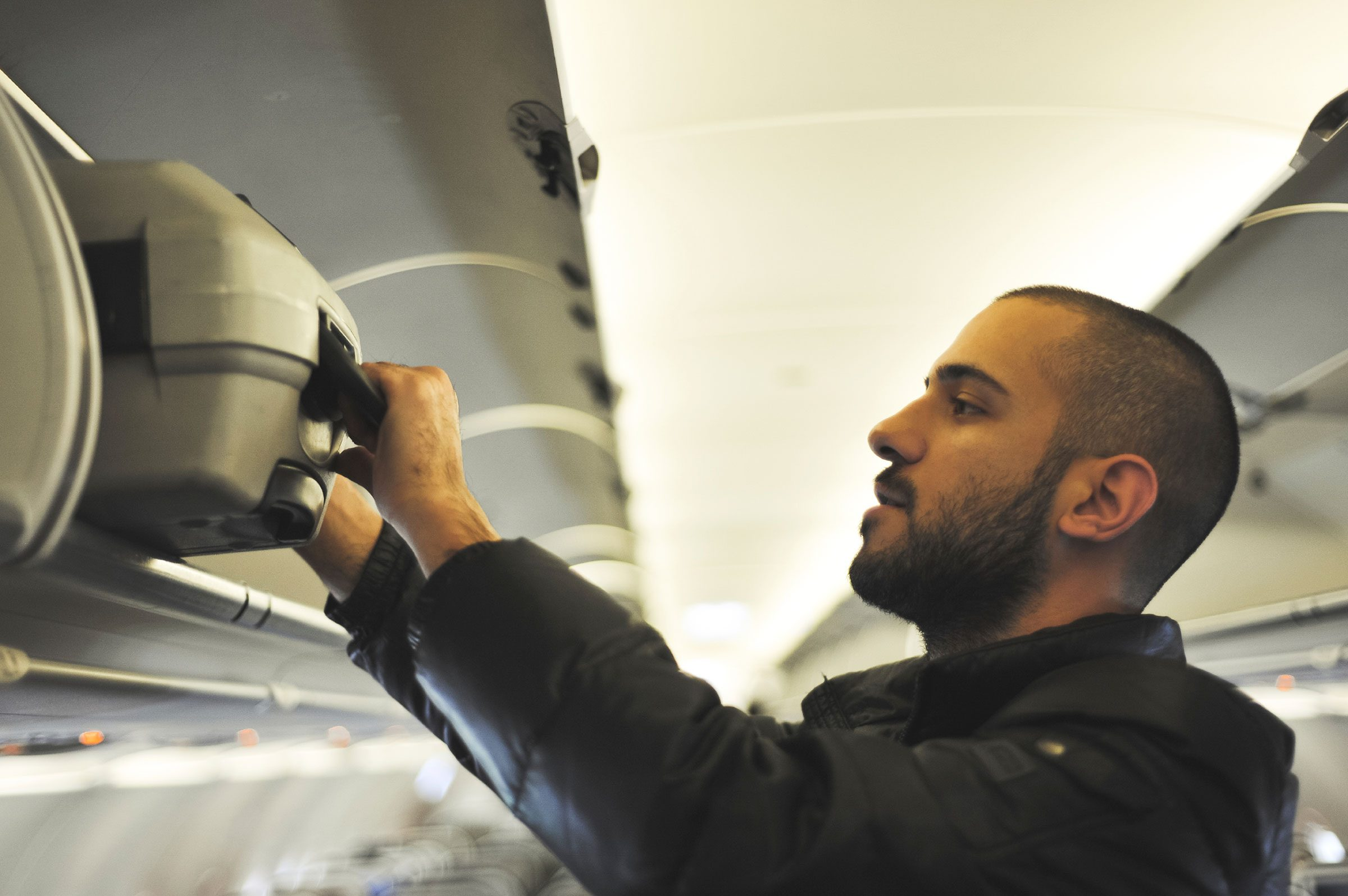 13 things your flight attendant wont tell you overhead luggage