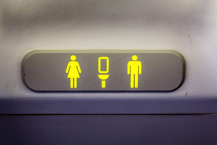 plane bathroom sign