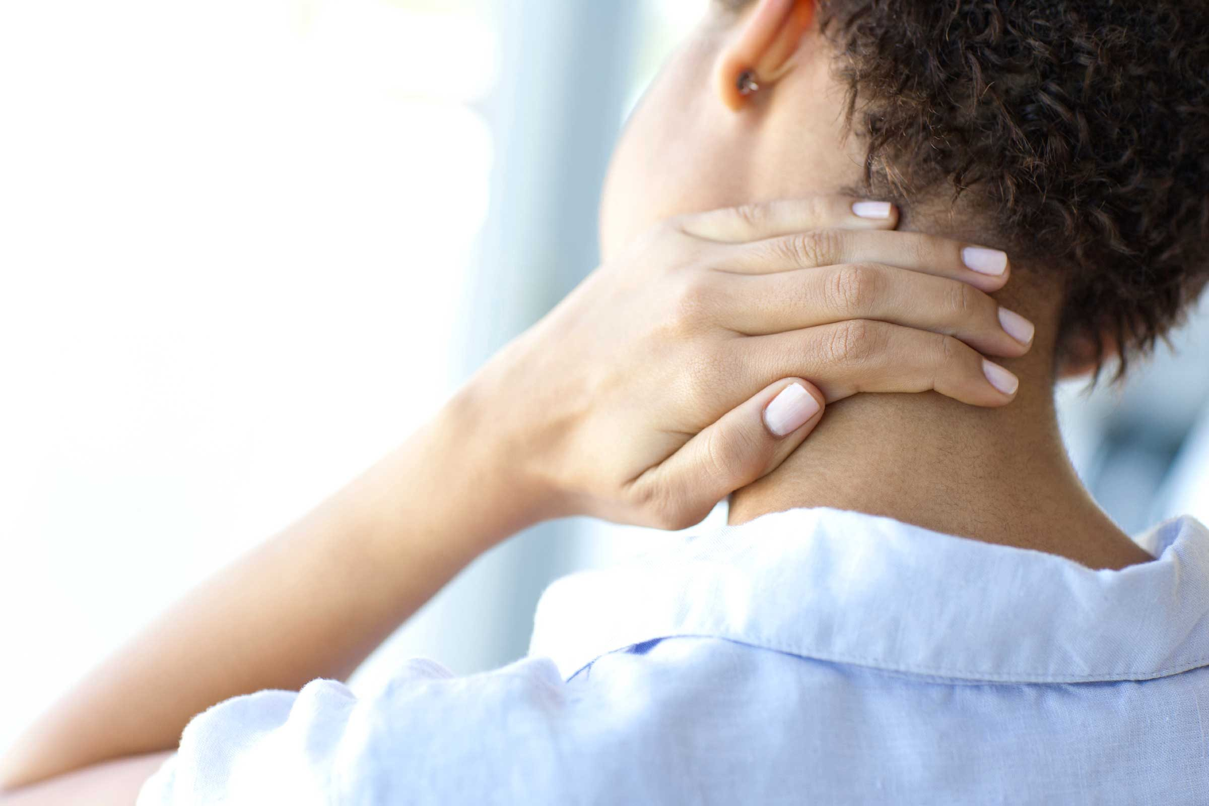 Muscle pain relief, woman rubs sore neck