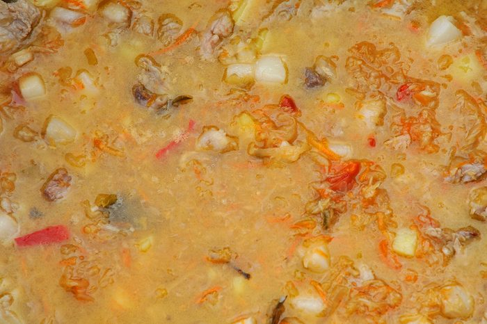 Soup with meat and vegetables. Close up, top view