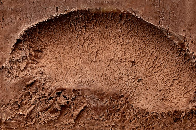 Scooped chocolate ice cream or chocolate ice cream from top or from above background