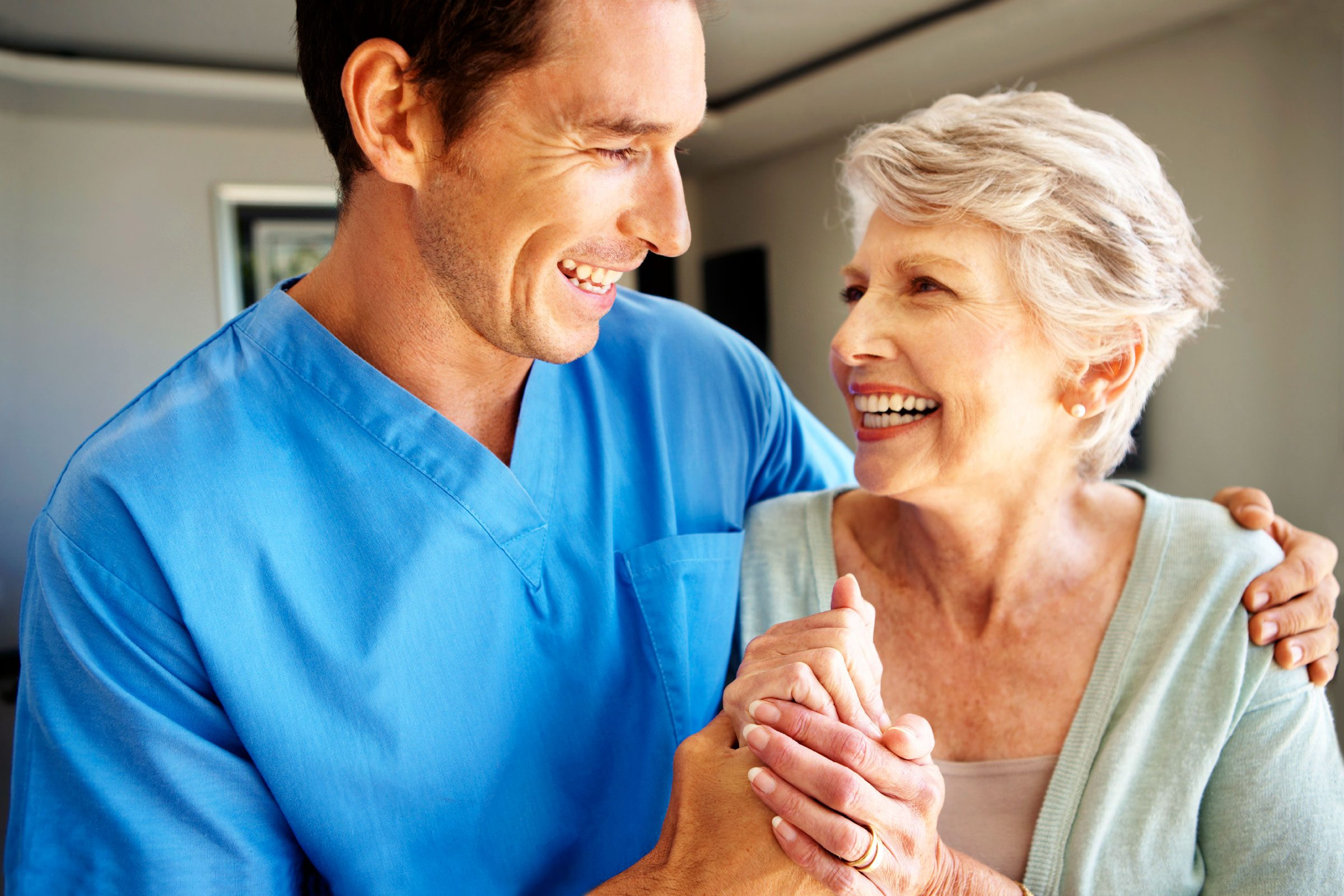healthcare worker hugging patient