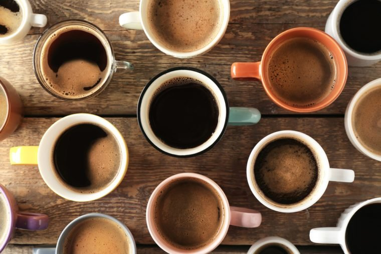Lots of coffee cups on wooden background