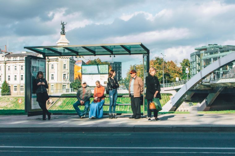 VILNIUS, LITHUANIA - SEPTEMBER 2017 - Crowd of different people standing on a bus stop.